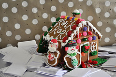 Gingerbread house atop white papers