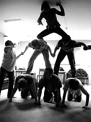 Pyramid pose by 7 persons